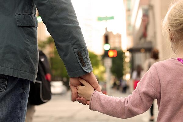 little girl holding father's hand-542332350
